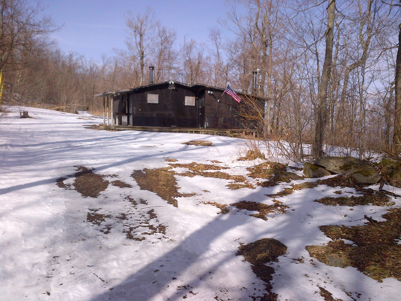 The logging road leads to this hunters cabin. From here you take a sharp right and head up until you can ascend no more.