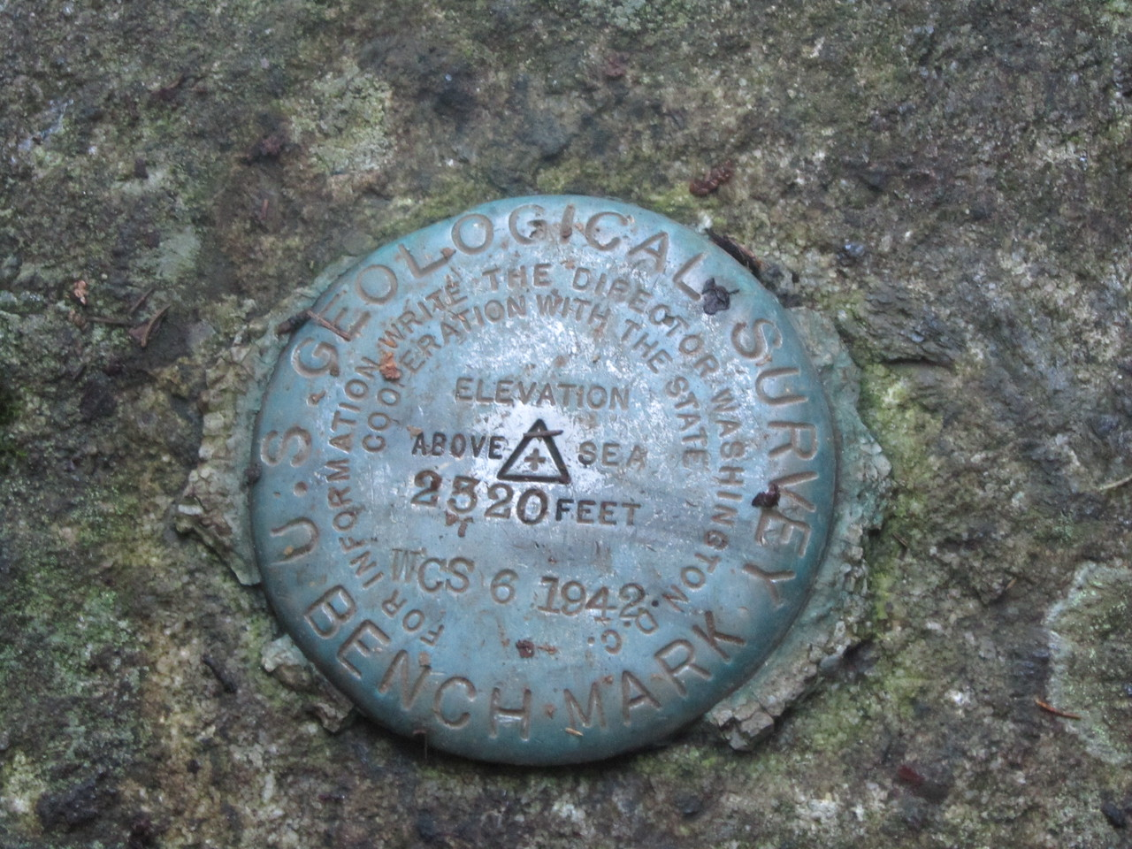 The USGS Survey plug at Dix lake campsite, where we slept Friday night. Dix is the 6th highest peak at 4857 feet so our first trail is over 2,500 foot ascent. Yippee...<br /> <br /> To ascend the highest peak in MI, (Mt Arvon @ 1979 feet) you must make the ascent of nearly 300 feet! Holy Cow, thats almost like Mount Everest. Bring your oxygen as rescue helicopters cannot fly that high in the thin air.