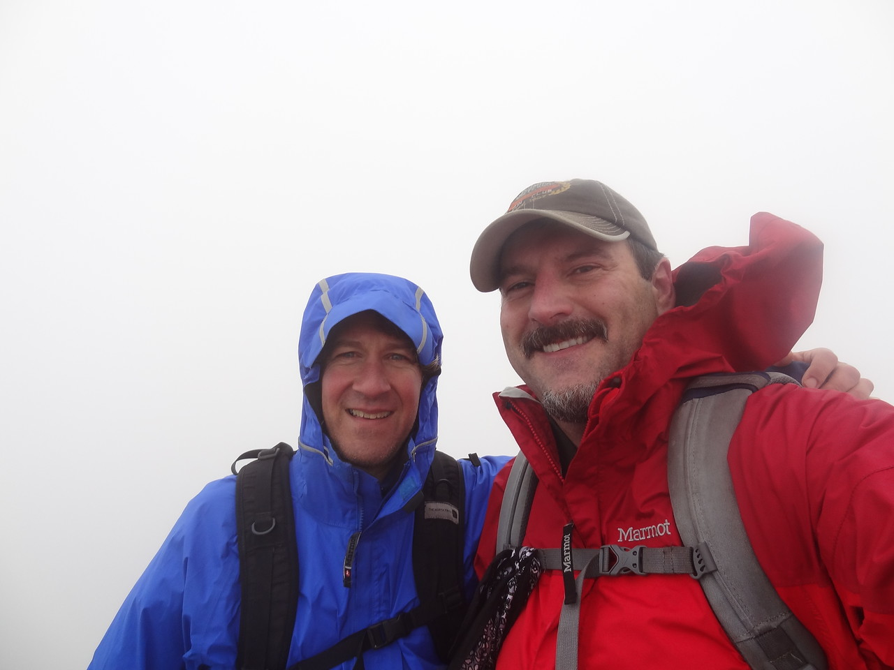 The summit of Haystack. We got a few very brief views but mostly a white Christmas. I may photoshop some views behind us. Maybe surfing in Hawaii. Aloha.