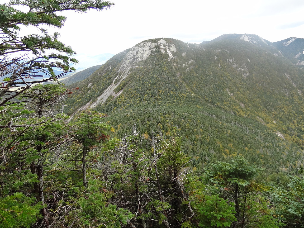 """Our first view of Saddleback and the famous """"cliffs"""". They look scary from here. The trail is to the right of the large slide and then up and over the stone."""