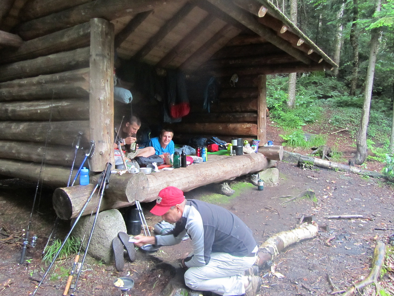 Our base camp for the night. Per usual, the boys are laying down while the men are getting it done. Rob cooking dinner, and me fighting off a hungry 300lb black bear trying to get to the trout.