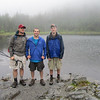 At Lake Arnold in the pouring rain. Boys still smiling, but then again they were hiking without packs while the old men with old men joints were packing the gear.(Rob with his painful swollen ankle wrapped in a brace & me with my painful swollen knee wrapped in a brace). But really boys, we want YOU to be happy! Are you thirsty? Just grab some water from Daddy's pack. Do you need some moleskin, bandage, food, ibuprofin, or directions, let me get that for you out of my pack.