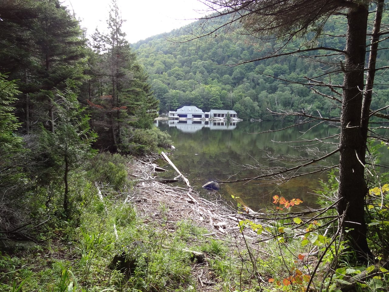 Along the west shore of the lake, you can see the Ausable Club boathouse. There were no fishermen out yet but on the way out, we saw a number of canoists enjoying the remote wilderness.