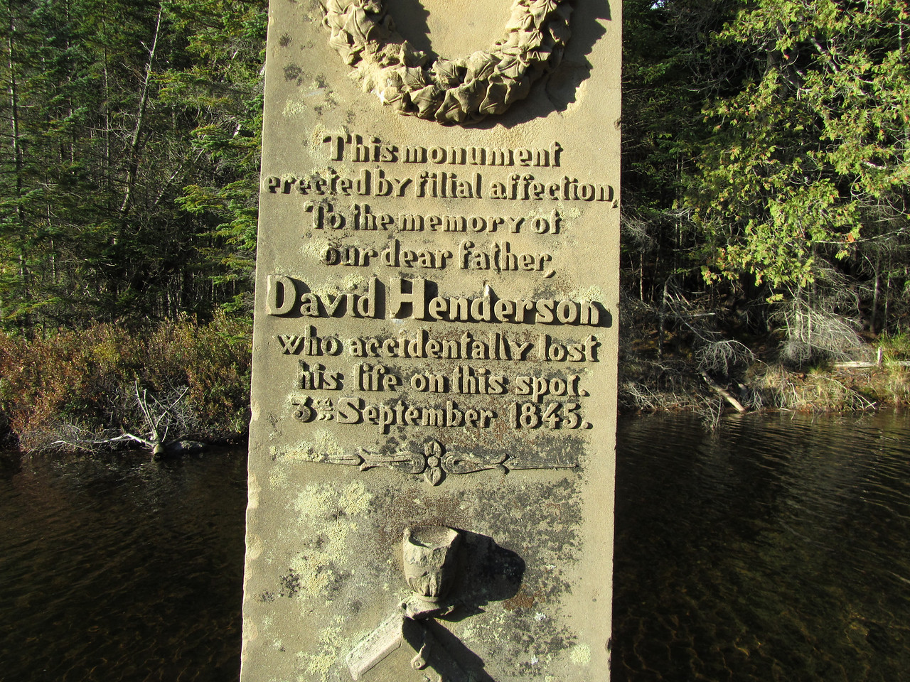 Monument is still in good shape. <br /> <br /> As the story goes, David, a guide and his son were surveying the area for mining when they stopped to fish. David set his flintlock muzzleloader pistol on a rock so it did not get wet and he hit the hammer firing a round into his abdomen. He died on the spot. This monument was a few tons and was brought to its remote location in the winter by two oxen and a sled.