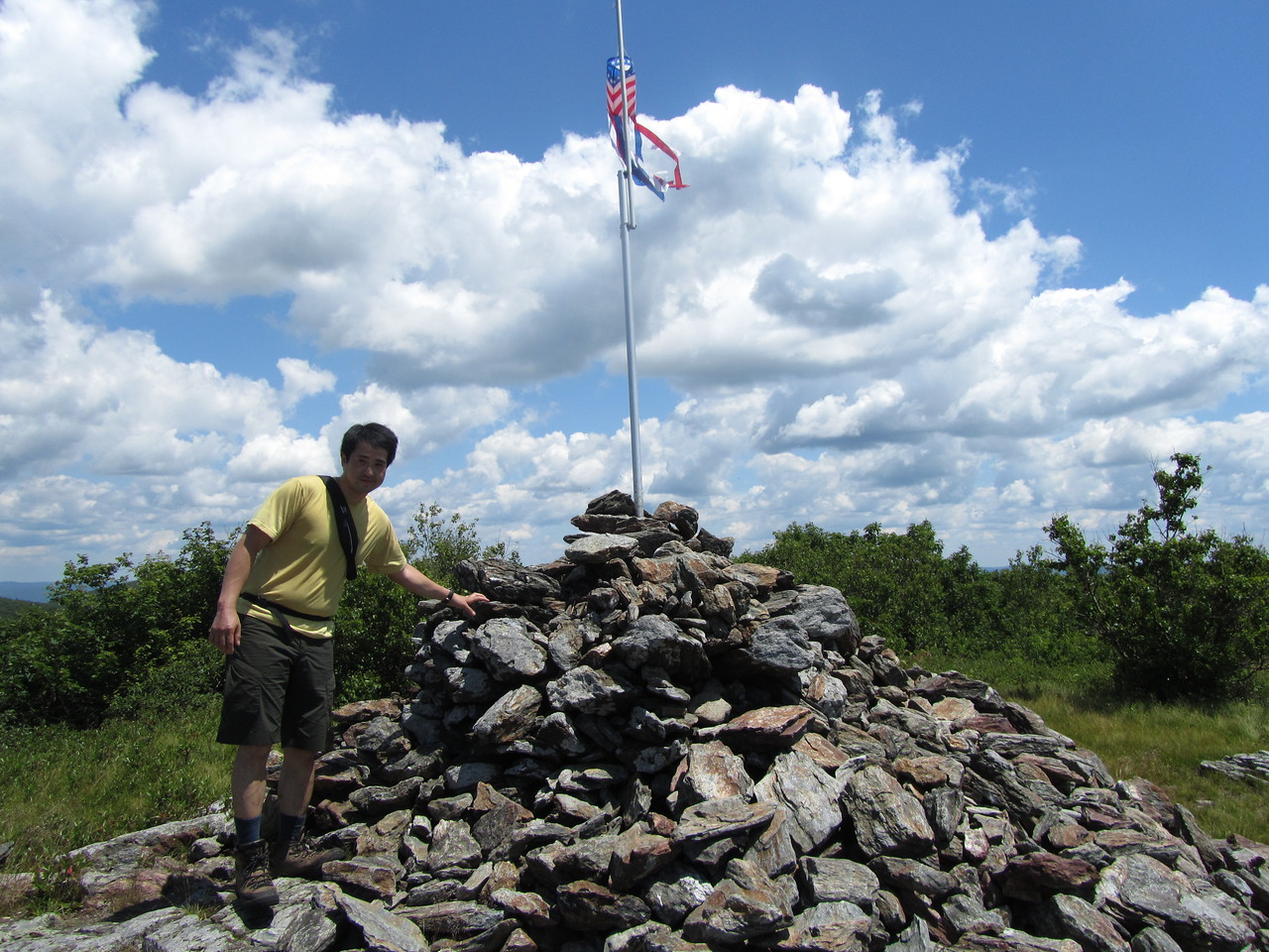Chachie at the summit cairn.