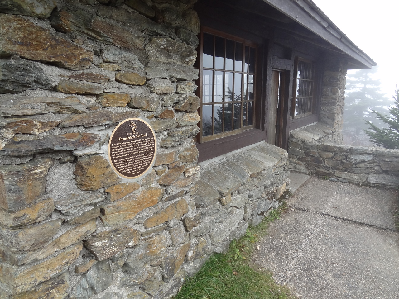 The Thunderbolt Ski Shelter was built in 1940 by the Civilian Conservation Corps atop the summit of Mt. Greylock (3,491 ft.).  The small stone building served as a warming hut for racers who made it to the summit by side-stepping the entire trail.  Here they warmed up and prepared for their run down the Thunderbolt.  The early races were timed by stopwatch.  Later, copper wire was run from the finish line to the summit, and the races were timed by two way radio.  This also added a bit of excitement for the spectators, as immediate results could be known and the times were announced over the loudspeaker as racers crossed the finish.