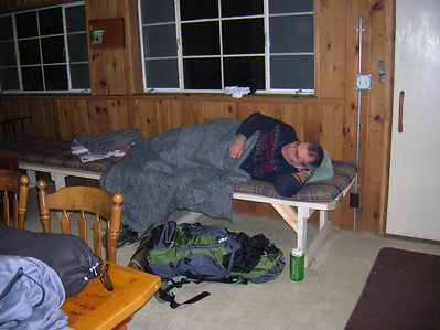 Mike readies for bed in the cottage.