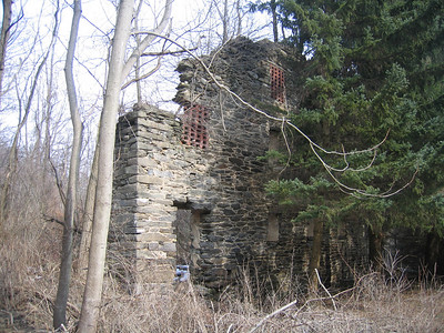 The remnants of an old stone barn along the trail