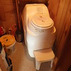 An electric composting toilet in our cabin did not require a septic system.  And it didn't smell either!