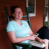 Bretta Relaxing on the porch back at Mountain Harbour B&B