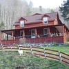 A goat keeps watch over the Mountain Harbour Bed & Breakfast in Roan Mountain Tennessee