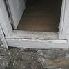 S side, door: threshold is split/broken