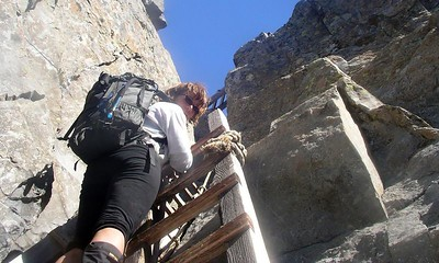 Climbing the creaky ladders to the summit.