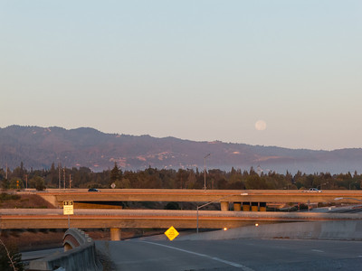 The full moon sinks over the Coastal Range as I head north--pulled up onto the Bascom Avenue exit to snap the shot. Luckily not many people around at 7 on a Sunday morning compared to weekdays.