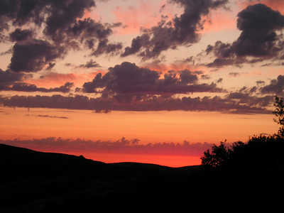 Amazing pink glow on the horizon as the sun sinks towards night.
