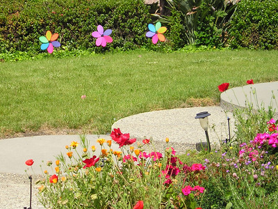 Whirlagig thingamabobs add color to this yard without having to actually plant any pesky real plants! But they also had genuine actual plants.