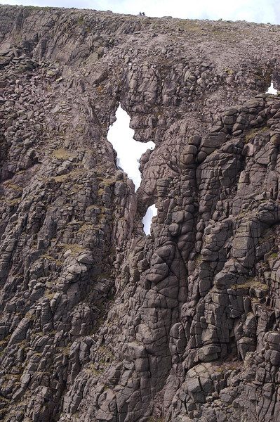 Magnificent rock gullies in Choire Bhrochain just below the summit of Braeriach.  Two human figures in the centre of the skyline give this some scale