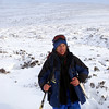 Gary on the long walk out through deep soft snow over trackless heather
