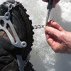 Field repair to Mil-Spec traction footwear.  Link connecting chain to plastic webbing pulled open.  Multi-tool made repair quick and convenient.