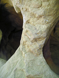 A rock pillar with a cave behind it.