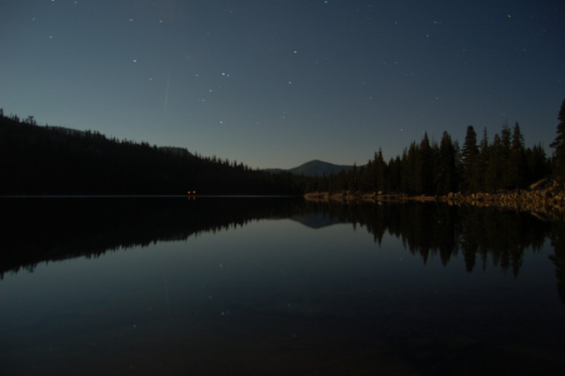 Stars over Lake Tenaya night before the hike.  Glow from campers' head lamps along the shore.  A one-minute exposure.  Note the streak from the jet in the sky.