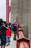Lisa on the Golden Gate Bridge amid other photographers.