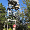 Alli poses in front of the fire tower.