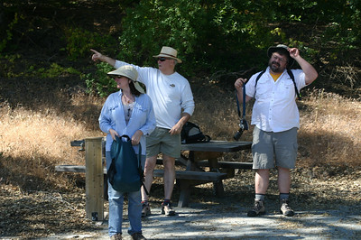 Here, Linda, Paul, and Pete discuss where the trail head might be.