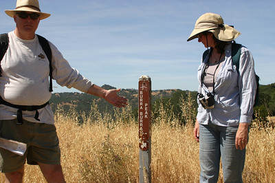 We had heard that the trails weren't well marked, but in fact, as Paul and Linda point out, there was a sign marking the trail from the road.