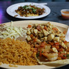 And here we have a fish taco and a shrimp taco with a side of rice and beans.