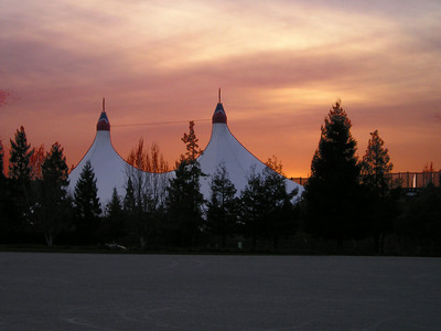 The shoreline amphitheater stood out against the expanding sunset.