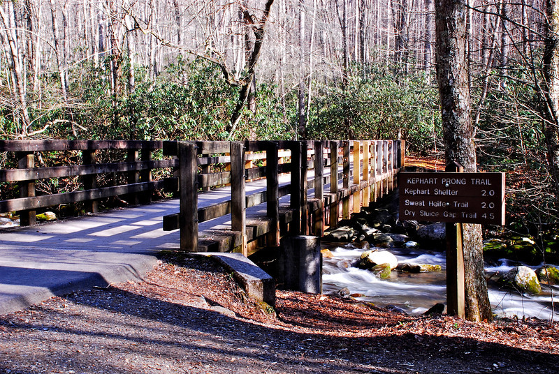 the trail begins with a bridge over the Oconaluftee River