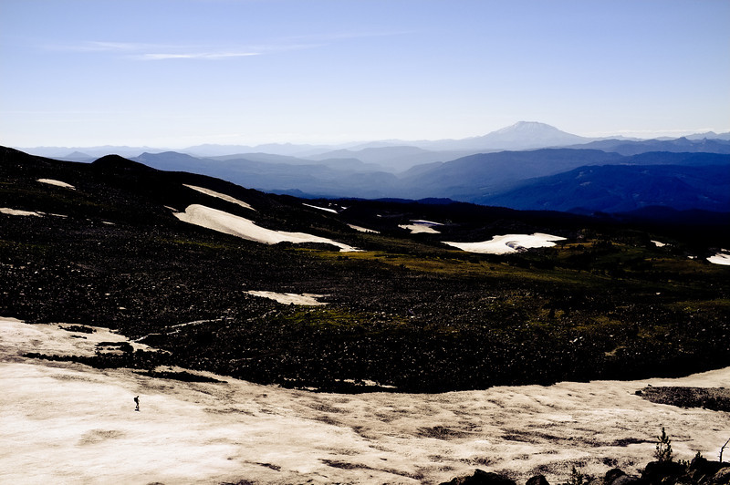 Guy hiking down the snowfield