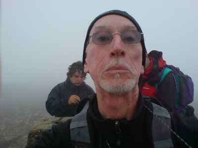 Me at Ben Nevis summit, Tim and Andy behind.  I don't know why I look so grim - it was hard, but not that hard!