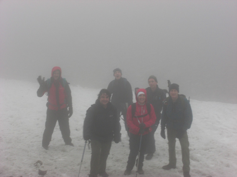 Playing in the snow on the descent from Ben Nevis