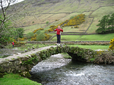 Angela tries to collapse the bridge over Mosedale Beck (behind the Wasdale Head Inn).
