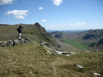 Martin points across Great Langdale towards Windermere