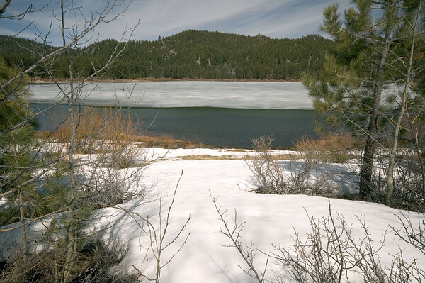 Spooner Lake is still mostly frozen.