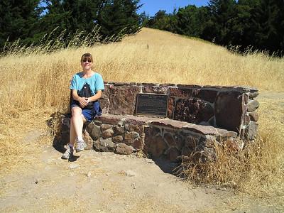 OLYMPUS DIGITAL CAMERA         Linda enjoying the view on the Wallace Stegner bench.