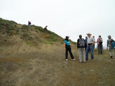 Pausing partway up Milagra Ridge.