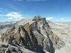 "Mt Muir, Mt Whitney, and the ""needles"" in between, from Discovery Pinnacle.  Note the Mt Whitney Trail at Trail Crest in the lower left corner."