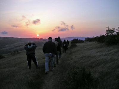 Sunset and hikers Monte Bello