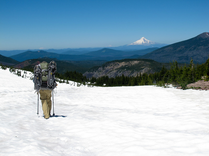 Hiking down a snowfield with Mt. Hood view