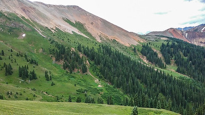 Rest of route, below the scree and above the trees, left to right.  Nancy's Grassy Peak the small reddish bump on the right.