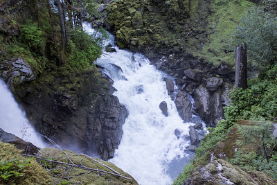 To the left is the base of the Nooksack Falls, and to the top is fast moving water from the NookSack River.