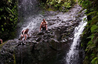 Maunawili Falls - After a Strong Rain.  My mother climbing up to jump off the falls.