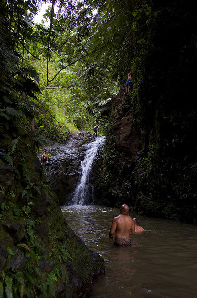 The Maunawili falls  There are three jumping points around the extremely deep pool- from directly off the falls; to the right along a ledge (guy in the blue shorts); and off, much higher up, to the left (not shown from this vantage point).