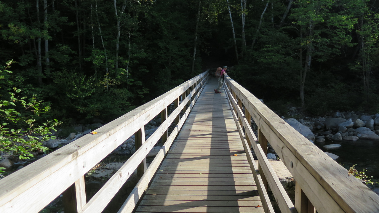 Beth enjoys the view from bridge crossing at Lincoln Brook.