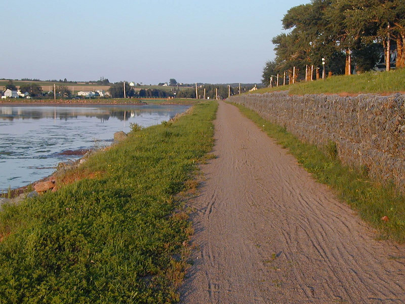 """End of St.Peter's Bay on PEI.  The gravel path is the Confederation Trail that runs the length of PEI. <br /> <a href=""""http://www.tourismpei.com/pei-confederation-trail"""">http://www.tourismpei.com/pei-confederation-trail</a>"""
