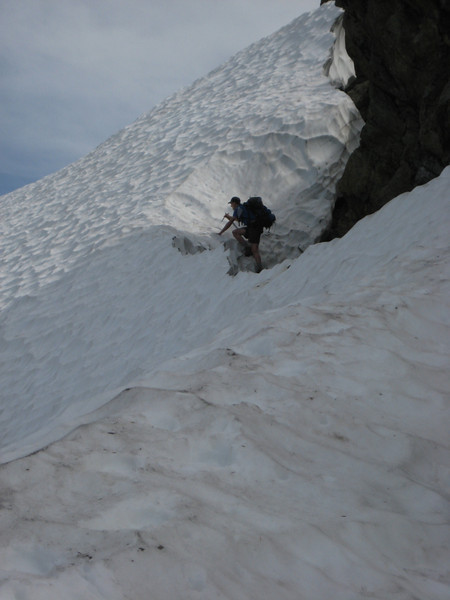 another hiker climbing out of the moat onto the snowfield